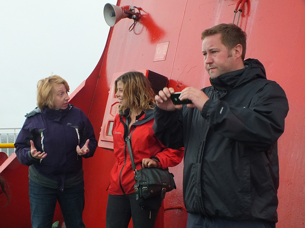 Sheltering behind the funnel on the way to Arran. DR Catherine McGavigan, Emma Downie and Gordon Mcdermid