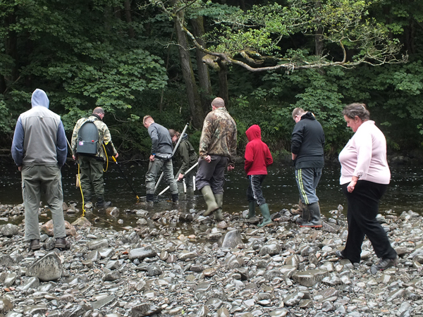 Balsam bashers from Colmonell watching an electrofishing demonstration