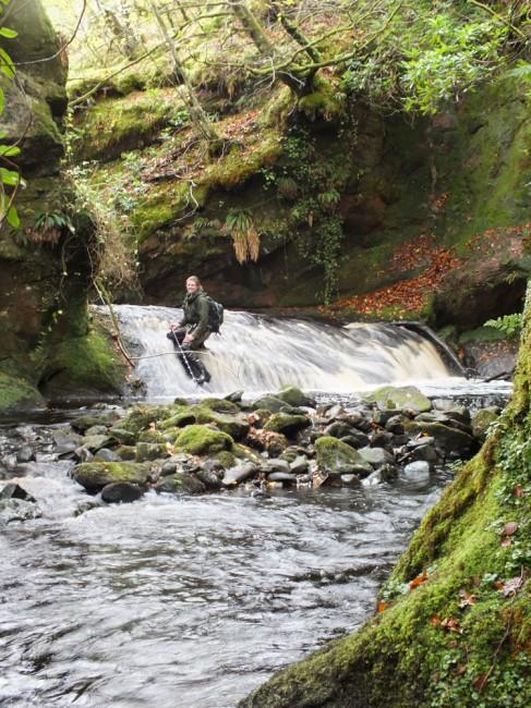 Helen climbing up a cascade (or taking a rest)