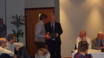 Our new chairman Bill Stafford presents Outgoing chairman Peter Kennedy with his gift