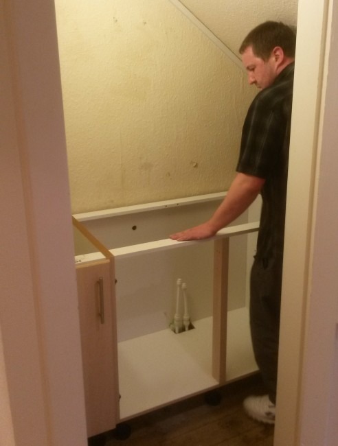 Gordon fitting the new sink unit.