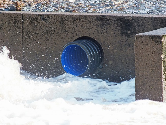 When water is flowing through this pipe, I expect some fish would be attracted to it rather than the fish pass unless it is screened to prevent access.