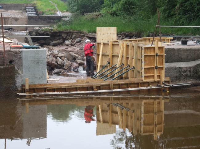 Joiners erecting shuttering on the left hand side of Anderson's