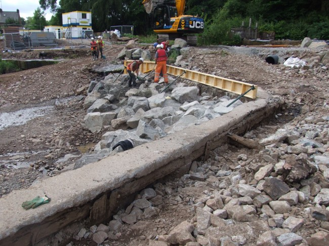 The foundation and shuttering at the lower edge of the weir. This will be reinforced before it is poured next week.