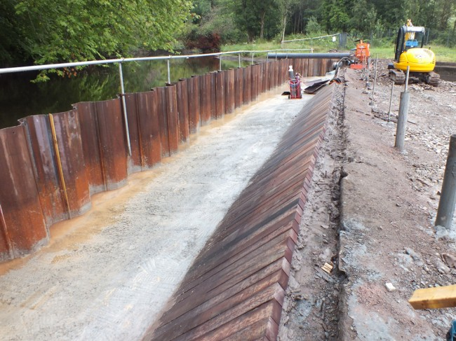 The new timbers fitted to the face of the dam to protect it for the next few hundred years.
