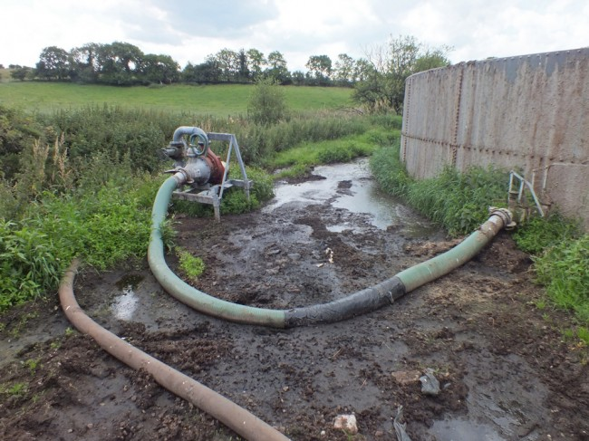 The sight that faced us on arrival at our site. Apart from a hose that is taped up, evidence of slurry spilling over the top of the tank and a shin deep pool of slurry with a steady flow of liquid entering the burn, there wan't much wrong with the location.