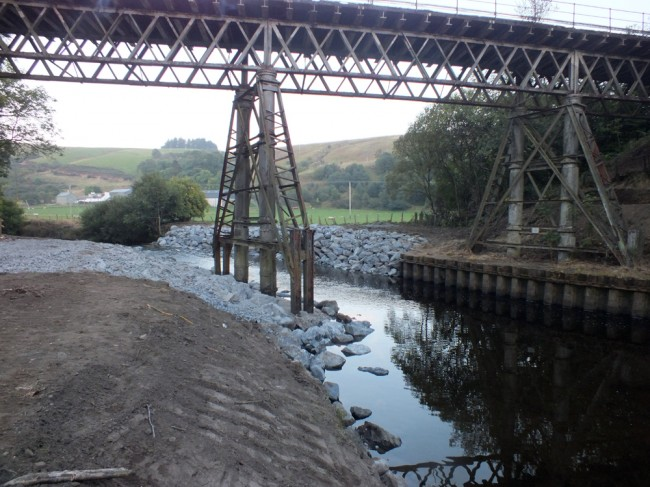 Looking upstream towards the new and inappropriate rock armour. Water used to flow on both sides of the bridge pier in the centre of the photo.