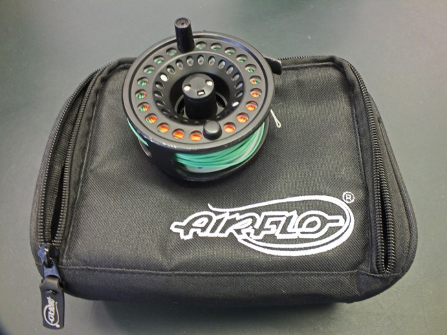 Airflo trout reel with spare cassettes and lines. In good working condition with marks from use.