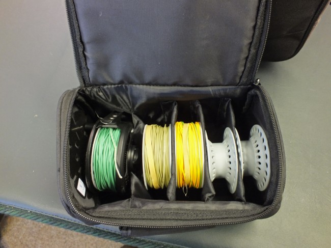 Airflow trout reel with spare cassettes and lines in case.