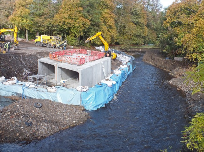 Two of the four culverts that will form the bridge are now in place. There's still a good bypass channel for the fish to migrate upstream