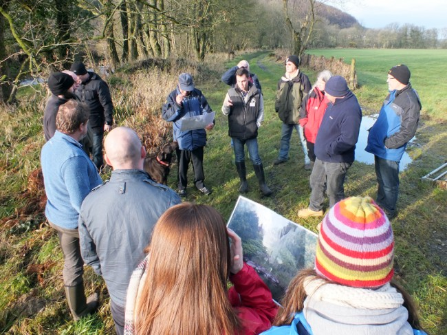 A group of attended discussing the effectiveness of control methods on the banks of the Luce