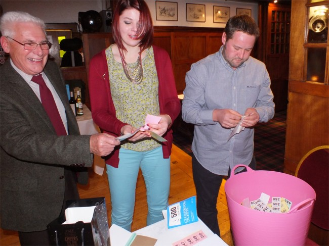 Tom Lothian, helen Downie and Gordon MacDermid sorting out the raffle.