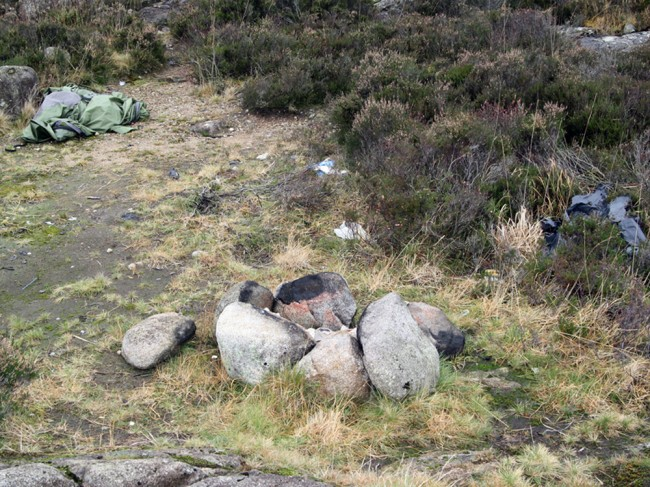 A tent left behind after a camping trip. Beer cans and bottles litter the area. If this is what Land Reform encourages, then I for one don't want more freedom for the masses. Where's the respect?