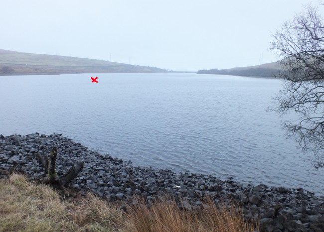 Caaf reservoir today after a week of rain. The red cross is approximately where Gordon was standing in the next photo.