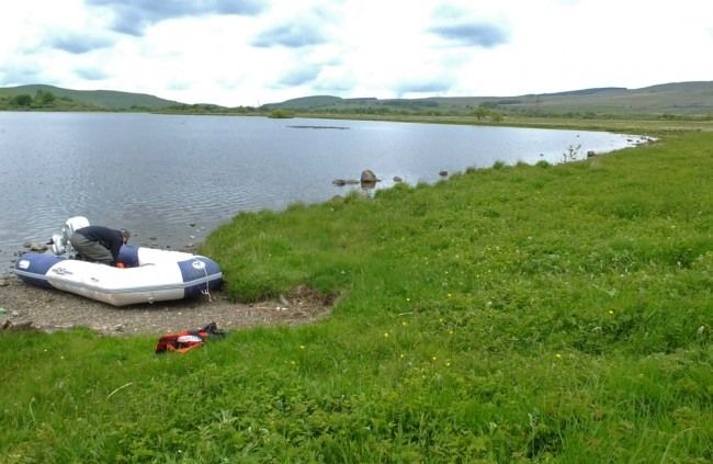 Muir getting the boat ready beside Bogton Loch at Dalmellington.