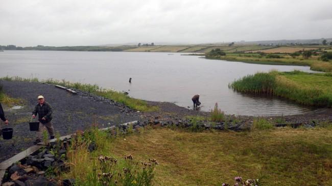 The last task of the day; stocking Kilbirmnie Loch with the catch.