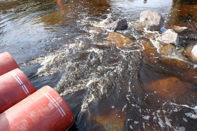 The outfall of the pipes have rock armour downstream to offer scour protection and creates turbulence that will  offer a degree of protection to fish