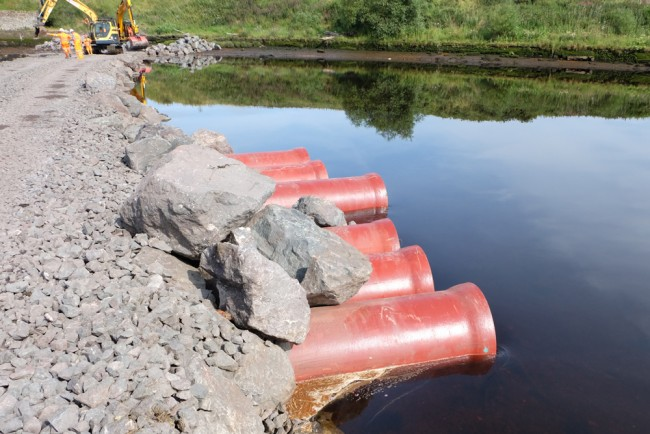 Currently 6 86 pipes are in place to allow fish passage to the river. A further array will be added towards the far bank near pier 3.