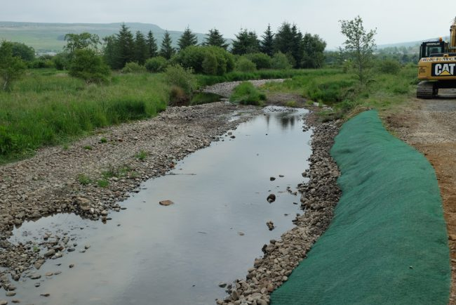 Contractors pinned the geotextile on top of should and 'as dug' rock that was used to rebuild the bank. Hopefully the grass seed will germinate quickly and hold the bank together.