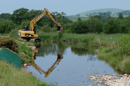 The advantage of using a large excavator was that boulders were placed either from the bank or dry gravel bars.