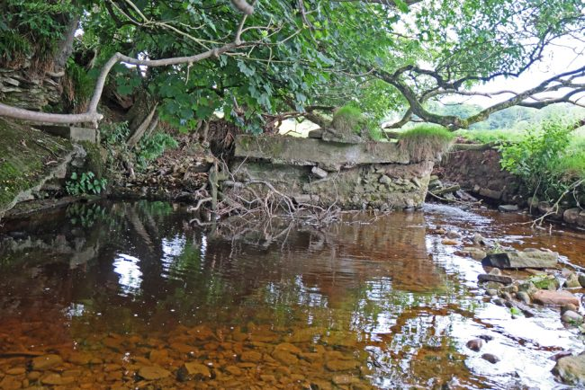 Floods scoured around this old weir and it would be better to remove this than leave it in place.