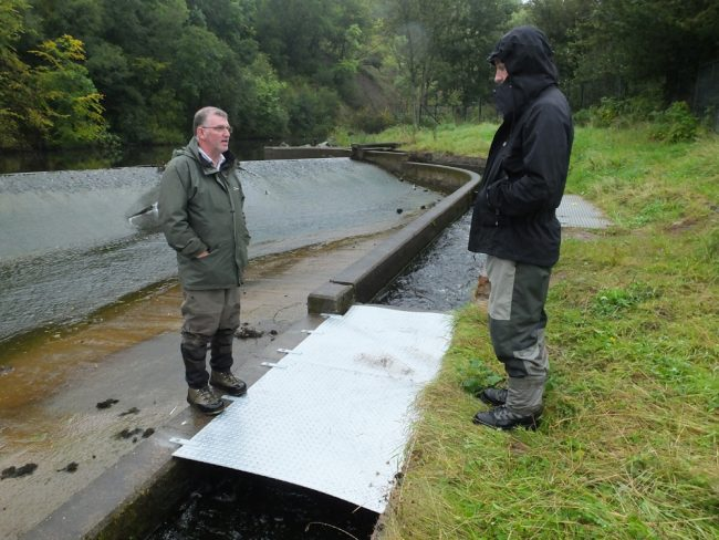 Stuart and Muir having a look at the Vaki installation at Catrine Dam.