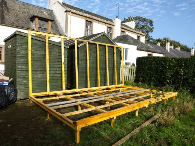 Getting there, the finished shed will have a pent roof to shed water.