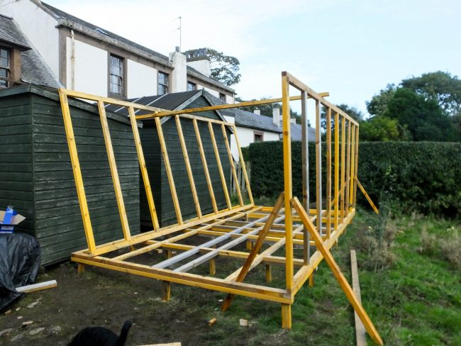 A base, and two side panels...given another couple of decent days we should finish the construction of the shed.